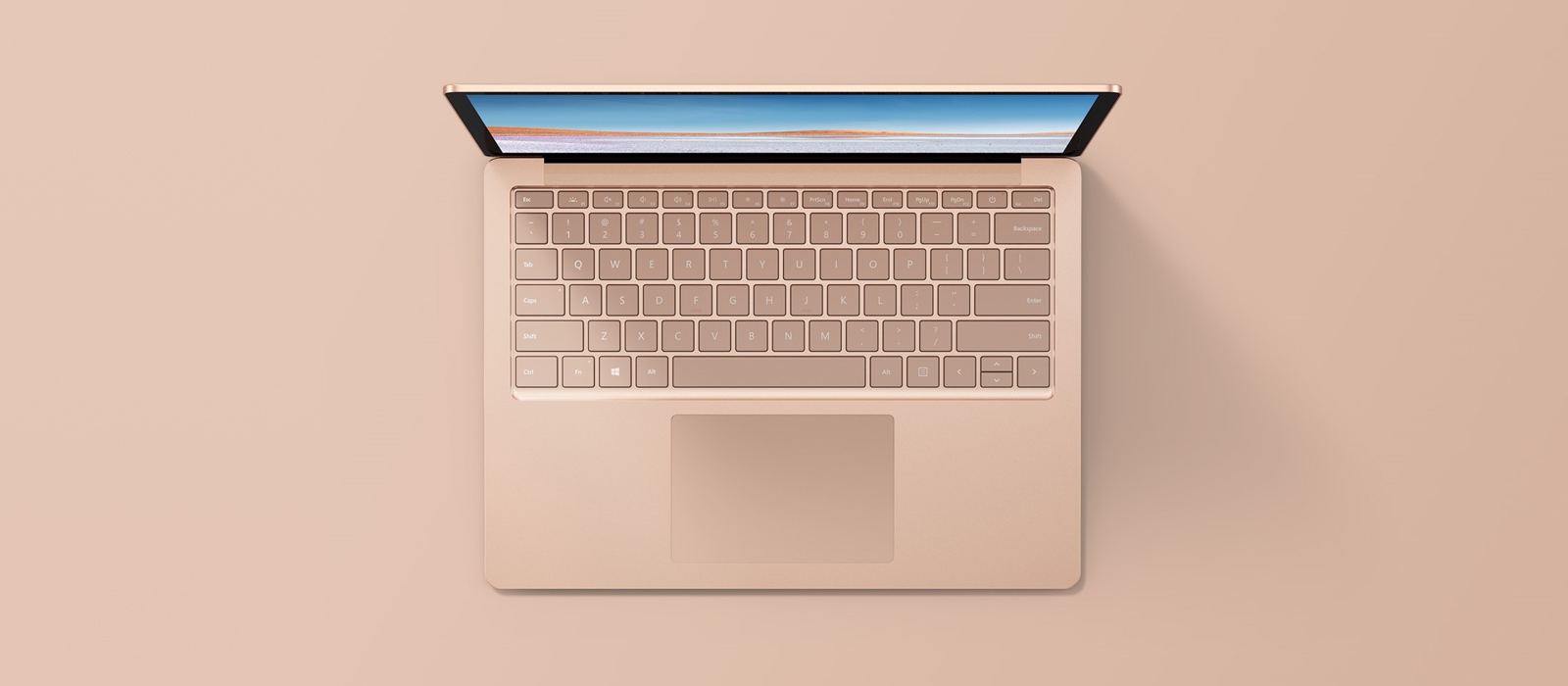 A Surface Laptop with Sandstone finish from a bird's eye view