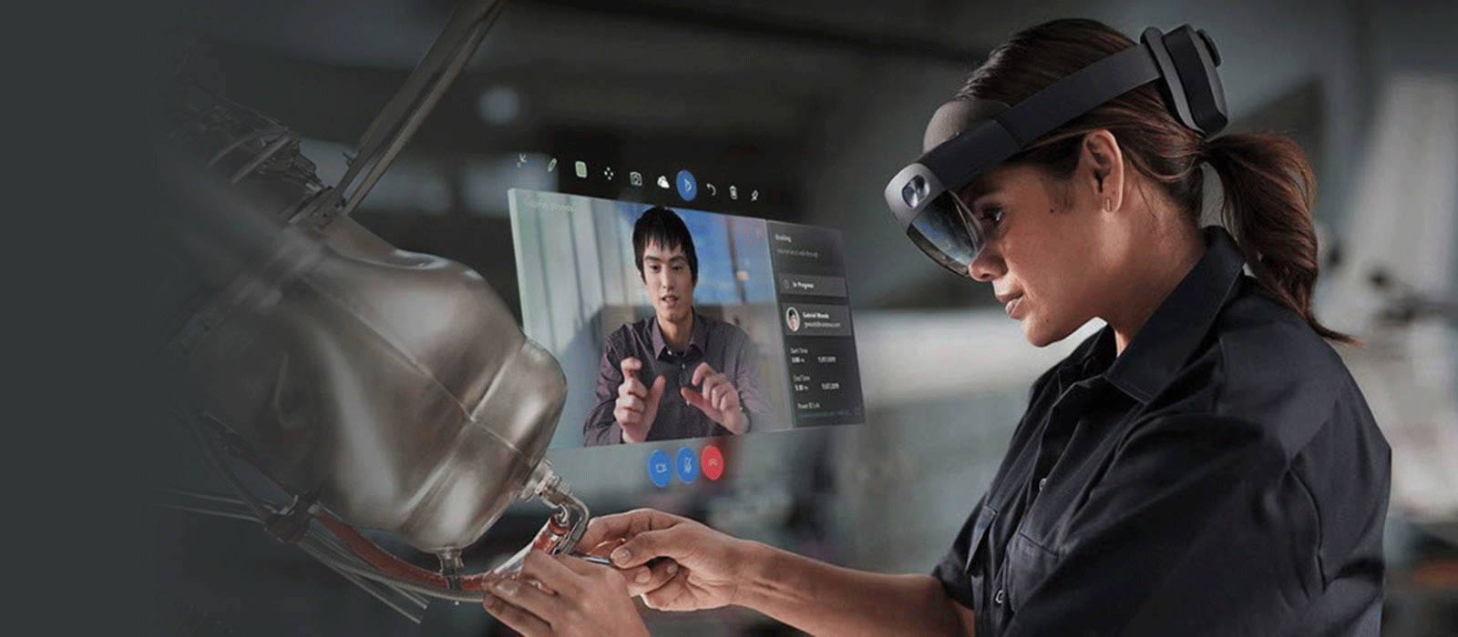 A woman is wearing the HoloLens 2 on her head and looks down